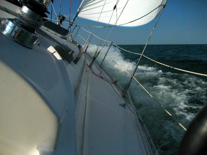 Why Crusiers Won't change RF headsails-washing-toe-rail.jpg